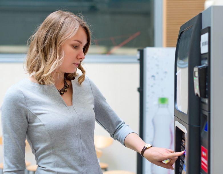 Woman Buying Drink at Vending Machine