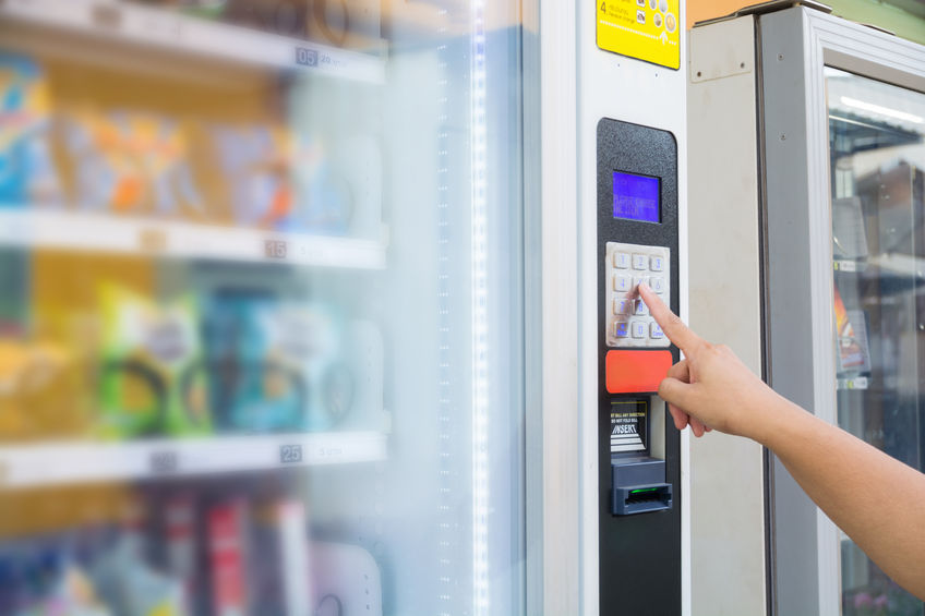 Person buying snack at vending machine
